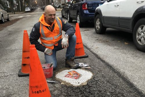 Artist fills gaping potholes with mosaics of rats, cockroaches and pigeons