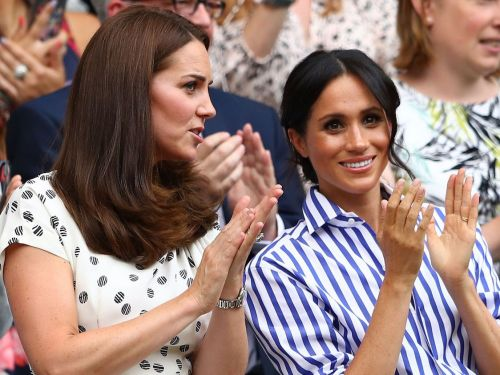 Meghan Markle's dad says she has a 'pained smile' - and he's worried she's buckling under the pressure