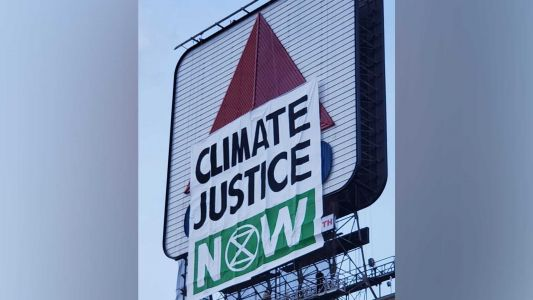 8 climate protesters arrested after hanging banner over Boston's Citgo sign, police say