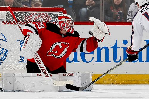 Devils' wild day of trades capped by 'emotional' win