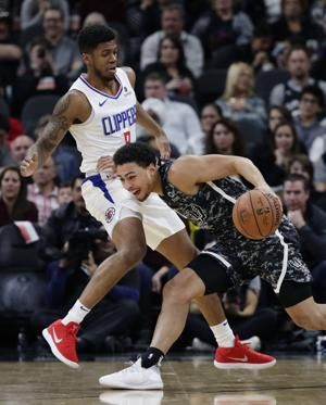 Harris' near triple-double leads Clippers by Spurs, 103-95