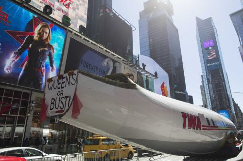 Vintage plane, soon to become bar, tours Times Square