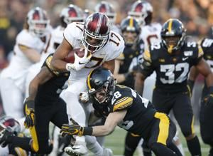 No. 23 Iowa hands No. 7 Minnesota its first loss, 23-19