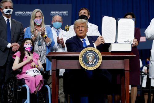Trump unveils health care plan, signs order protecting preexisting conditions