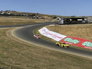 The Latest: Truex holds off Busch to defend Sonoma title