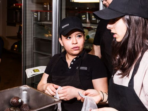 Chipotle is paying its employees' college. Here are 15 major companies that will help you pay for school