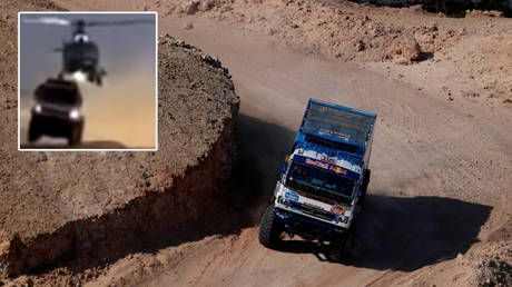 Helicopter rips roof of Russian team's truck in mid-air collision as Dakar rally in Saudi Arabia claims yet another crash