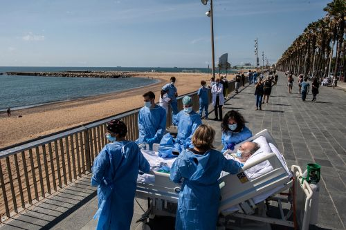 Doctors in Spain are wheeling recovering coronavirus patients to the beach