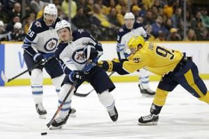Hellebuyck's 38 saves lead Jets past Predators 2-1