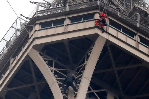 Eiffel Tower evacuated after man climbs iconic structure