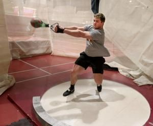 Northern's Tanner Berg takes to weight throw