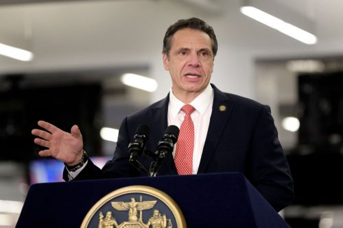 Cuomo defends wanting upstate budget director on MTA board