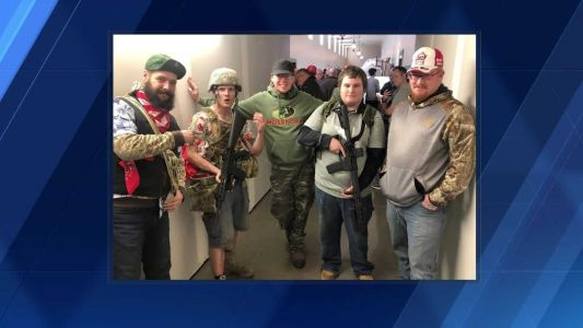 Gun rights advocates bring rifles to capitol in opposition to proposed legislation