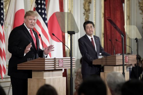 Trump breaks with Abe, says not bothered by NK missile tests