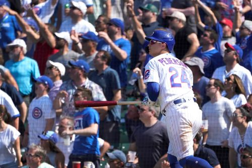 Chicago Cubs rally to beat the St. Louis Cardinals 8-5, extending their division lead over their rivals in front of 35,112 raucous fans at Wrigley Field