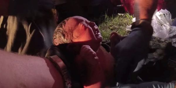 Shocking footage captures the moment law enforcement found a newborn baby girl alive in a plastic bag left in a wooded area
