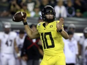 Herbert throws 5 TDs, No. 15 Oregon stomps Montana