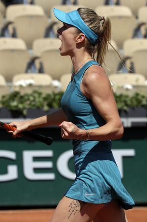 The Latest: Kyrgios out of French Open with injured elbow