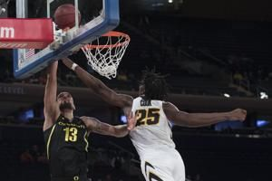 The Latest: Iowa tops No. 13 Oregon 77-69