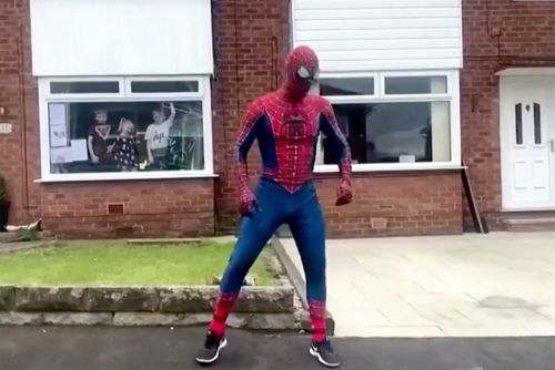 Spider-Man to the rescue! Superhero jogger cheers up kids in England