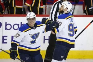 Blues get 1st SO win, beat Flames 5-4