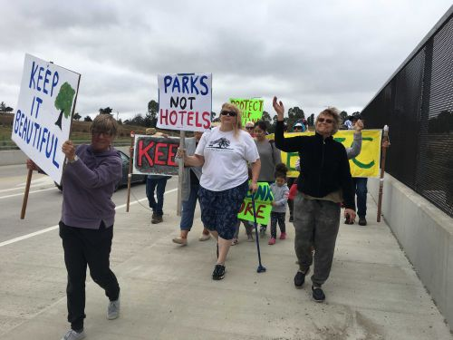 Protesters rally against proposed commercial development along Hwy 101