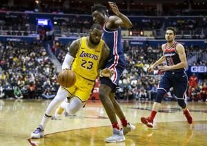 Wall's 40, 14 lead Wiz past Lakers 128-110; LBJ scores 13