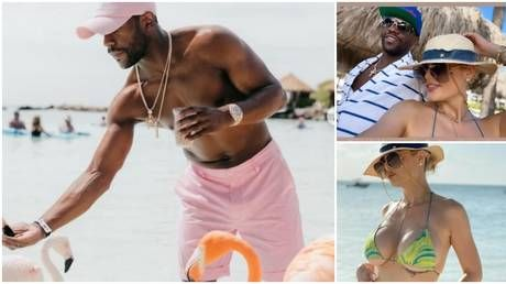 In the pink: Floyd Mayweather feeds flamingos as he holidays in Aruba alongside 'girlfriend' Anna Monroe