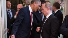 Former Obama Photographer Shows 'How You're Supposed To Deal With' Putin