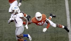 No. 15 Texas beats Kansas 50-48 on last-second FG
