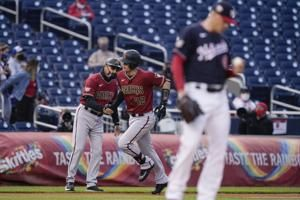 Young's slam off Corbin helps D'backs top booed Nats 11-6