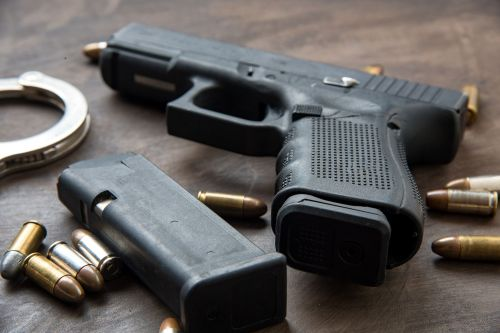 Police employee charged with selling department-owned guns