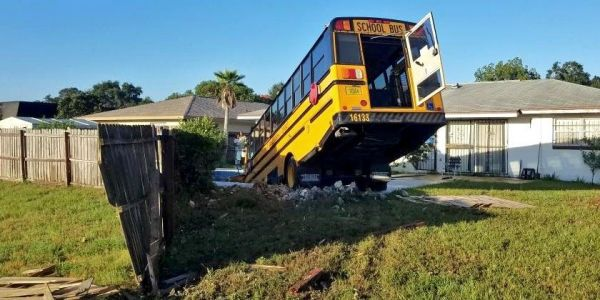 A school bus carrying 9 children in Orlando crashed into someone's yard and nose-dived into a swimming pool