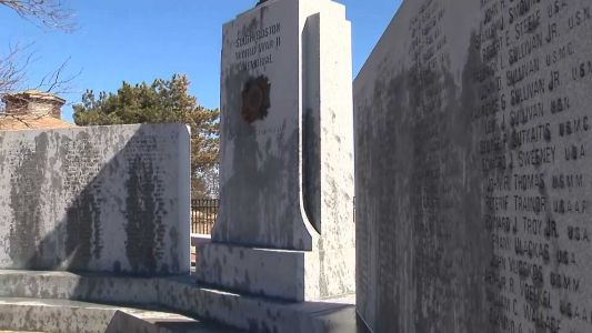 Residents step in to help repair World War II memorial vandalized with oil