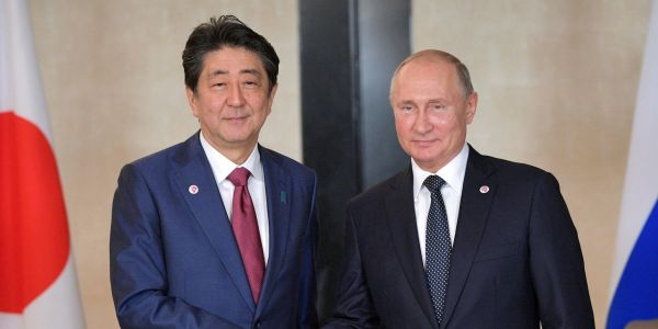 Japan's Abe tells Putin he won't let US troops on long-disputed islands if Russia returns them to Japan