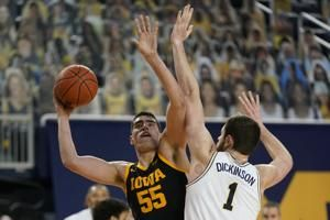 Dickinson impresses as No. 3 Michigan routs No. 9 Iowa 79-57