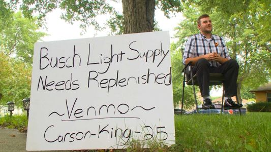This man's sign asking for beer money was wildly successful - now he's donating $6,000 to charity