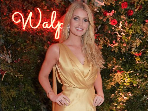 Princess Diana's niece Lady Kitty Spencer is engaged, and her eternity-style diamond ring could be worth up to $160,000, according to experts