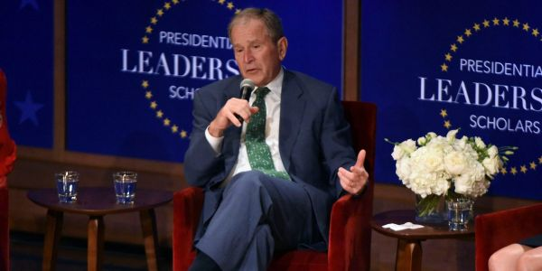 George W. Bush says it remains a 'shocking failure' that African Americans are 'harassed and threatened in their own country'
