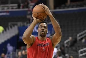 Dwight Howard sits out Wizards' opener with sore buttocks