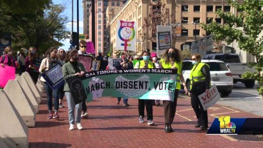 Baltimore Women's March participants rally at symbolic locations
