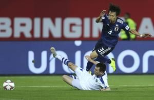 Japan beats Uzbekistan 2-1 to keep perfect Asian Cup record