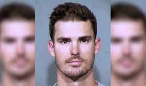 Padres pitcher arrested after allegedly crawling through stranger's doggy door
