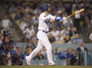 Dodgers outslug Cubs with 4 homers to win 7-3