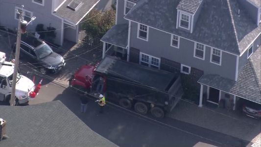 Dump truck crashes into Hingham house