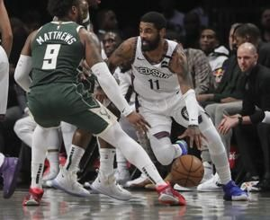 Nets' Irving sits out vs 76ers with hamstring tightness