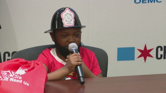 'Wouldn't be here:' Officials honor 7-year-old Chicago boy who called 911 when mom was having seizure