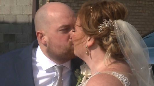 Surprise wedding parade greets couple who had to cancel plans