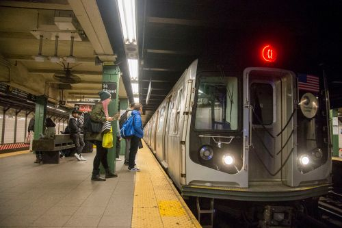 Bystanders save woman shoved onto subway tracks
