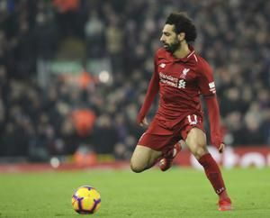 Salah nets 2 as Liverpool beats Palace to keep up title push